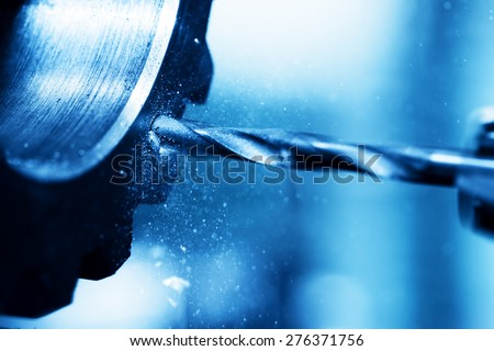 CNC turning, drilling and boring machine at work close-up. Industry, industrial concept. - stock photo