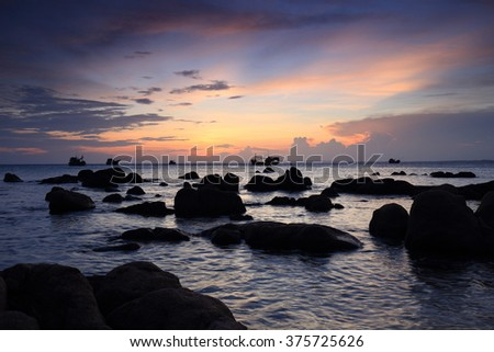 Co Thach Beach in the Sun Set, Tuy Phong District, Binh Thuan Province, Vietnam. There are a lot of rock, purple sky in the beautiful sunset.