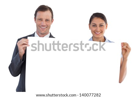 Co workers holding a blank copy space on white background - stock photo