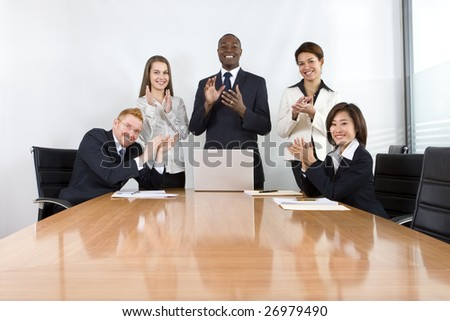 Co-workers in business meeting - stock photo