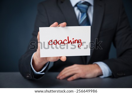 Coach advertisement concept. Man show card with text coaching.  - stock photo