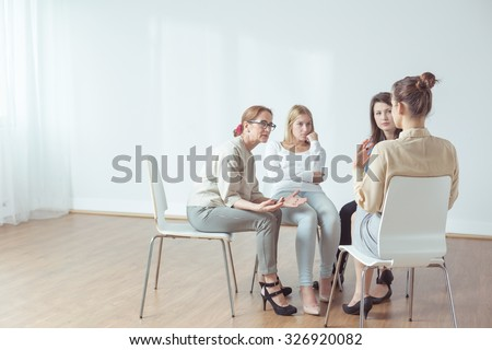 Coach and support group during psychological therapy - stock photo