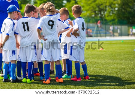 Coach giving young soccer team instructions. Youth soccer team before final game. Football; soccer; handball; volleyball; match for children. Football soccer game. Soccer football background. - stock photo
