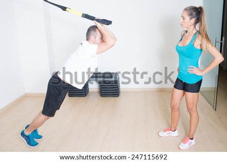 Coach helps with suspension training