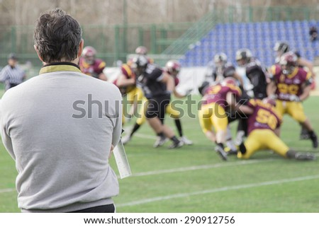 Coach observing football match - stock photo