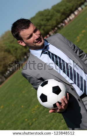 coach with ball in the hand - stock photo