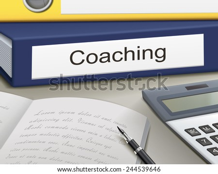 coaching binders isolated on the office table - stock photo