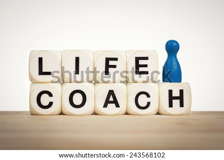 Coaching concept: Blue pawn next to word Life coach spelled by toy dice - stock photo