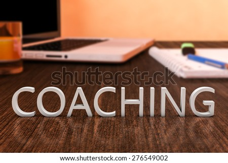 Coaching - letters on wooden desk with laptop computer and a notebook. 3d render illustration. - stock photo