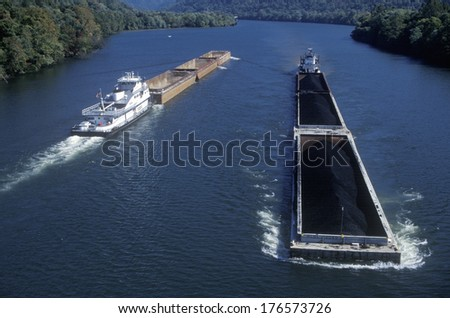 Coal Barges on  the Kanawha River in Charleston, West Virginia - stock photo