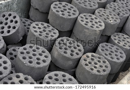 Coal briquettes in China to heat the houses in winter time - stock photo