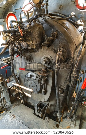 Coal engine in an old locomotive powerful engine  - stock photo