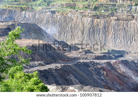 Coal fire in opencast coal mine - stock photo