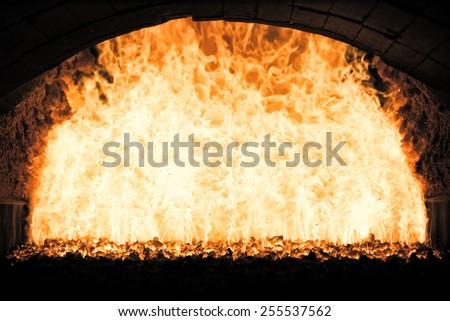 Coal fire inside steam boiler - stock photo
