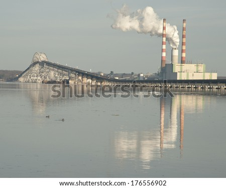 Coal fired power plant at river's edge - stock photo