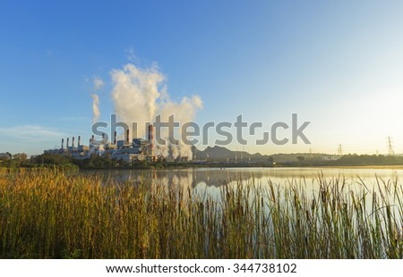 Coal-Fired Power Plant at sunrise time - stock photo