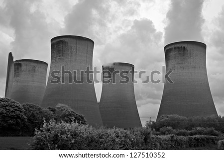 Coal fired power station cooling towers - stock photo