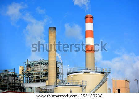 Coal Fossil Fuel Power Plant Smokestack with Red and White Colored Stripes Emits Carbon Dioxide Pollution - stock photo