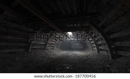 Coal mine dark tunnel - stock photo