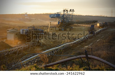 Coal mine three large excavator machine - stock photo