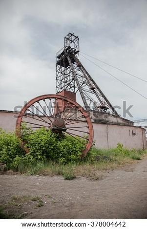 Coal mine tower on blue sky - stock photo