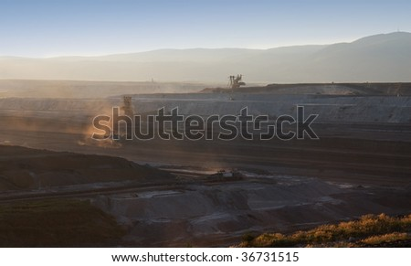 coal mine with excavator in czech republic - stock photo