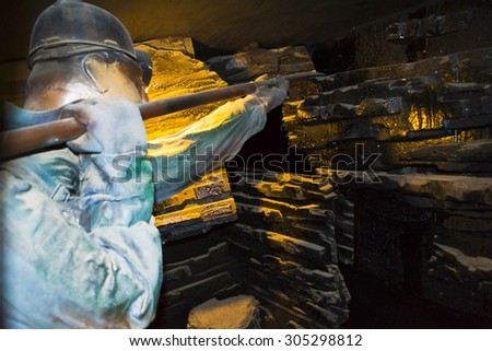 Coal Miner At Work Picking Coal In Mine