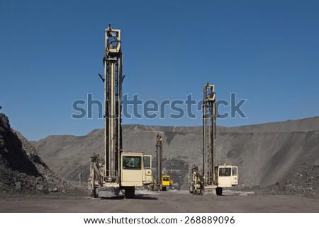 Coal mining. Drilling machine. - stock photo