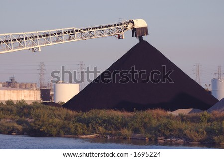 Coal pile in progress - stock photo