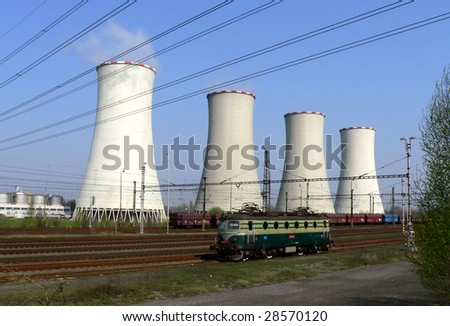 Coal power plant with cooling towers and locomotive in front