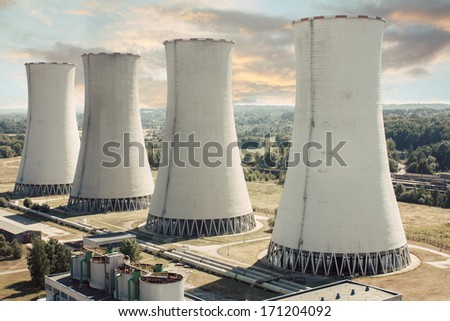 coal power station with four chimneys (cooling towers) - stock photo