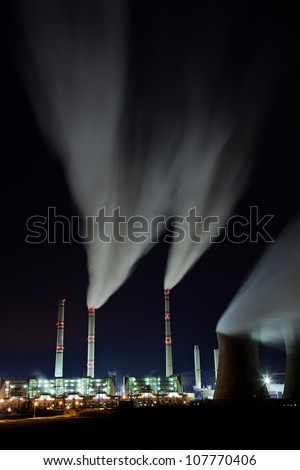 Coal powerplant air emission at the night - stock photo