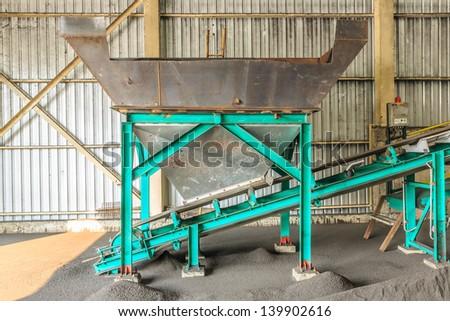 coal silo with conveyor belt - stock photo