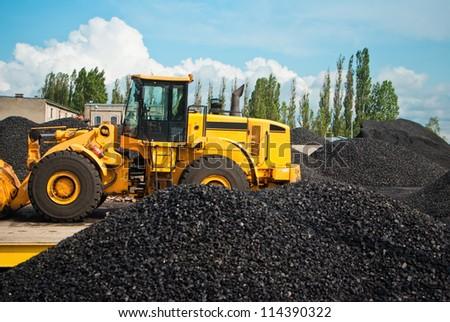 coal storage and bulldozer - stock photo