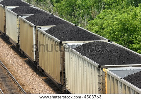 Coal train running in the midwest. - stock photo
