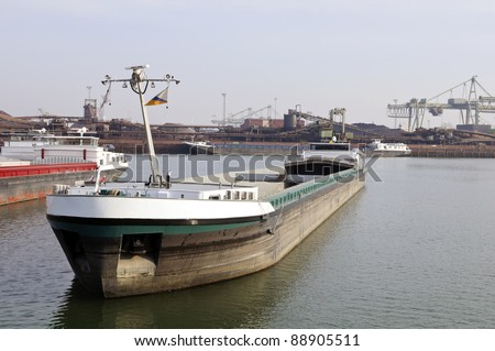 coal transport ship in the port of rotterdam - stock photo