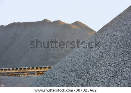 Coal yard with supply in heaps for industrial use - stock photo