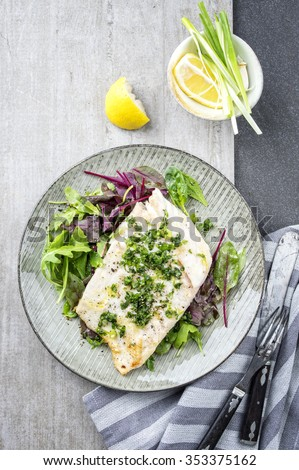 Coalfish Filet with Mixed Salad on Plate - stock photo