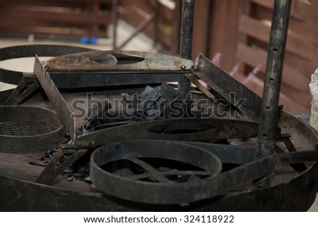 coals in the barbecue on the nature - stock photo