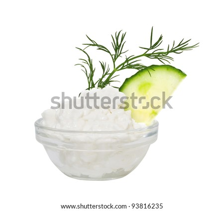 Coarse-grained cottage cheese with fennel and a cucumber. Isolated on a white background. - stock photo