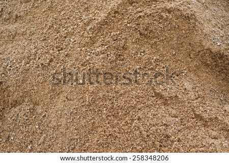 Coarse sand background texture. Closeup of coarse sand grains. - stock photo
