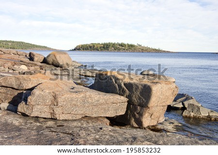 Coast and coastline at UNESCO High Coast Heritage, Sweden. Huge boulders, stones, rocks and cliffs along the coast. Isostasy close to one cm per year.  - stock photo