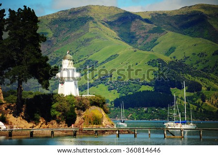 Coast and french village of Akaroa, New Zealand, South Island. - stock photo