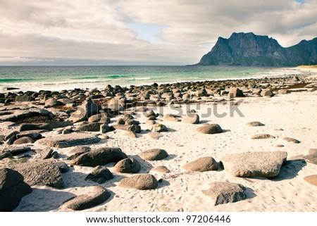 Coast beach in Norway, Unstad, Lofoten - stock photo