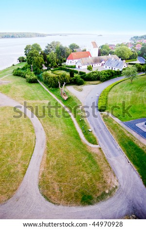 Coast green road in Svendborg, Denmark - stock photo