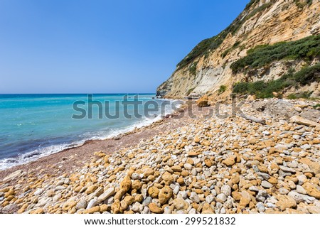 Coast landscape with stony beach, mountain and blue sea in Kefalonia Greece - stock photo