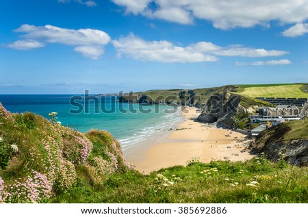 Coast of Cornwall with a Sandy Beach and Blue Sky - stock photo
