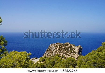Coast of Ibiza, the sea and the rocks.