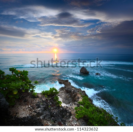 Coast of Indian ocean at sunset. South of Bali, Indonesia - stock photo
