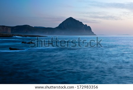 coast of Sicily after sunset, at dawn